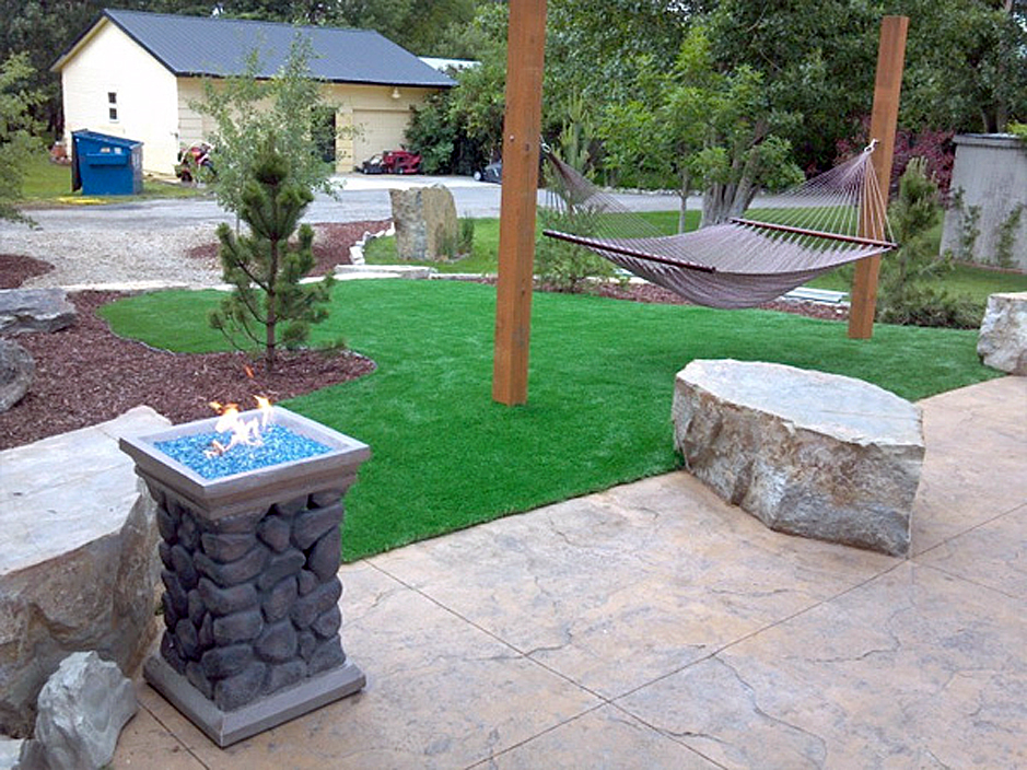 Synthetic grass cost cooper city florida landscape rock for Cost to landscape front yard
